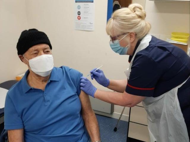 Thornbrook Nurse Trisha Longden gives the first vaccine in January