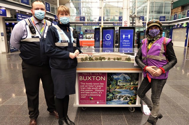 Friends of Buxton Station secretary Sue Mellor, right, promoting the town to visitors at Manchester Piccadilly sation.