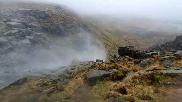 Kinder Scout waterfall flows upwards due to high winds.