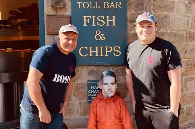 Toll Bar Fish and Chips owner Pete Grafton (left) with his son Harry (right) and in the middle is six-year-old Hayden Normi - or is it Tom Cruise?!