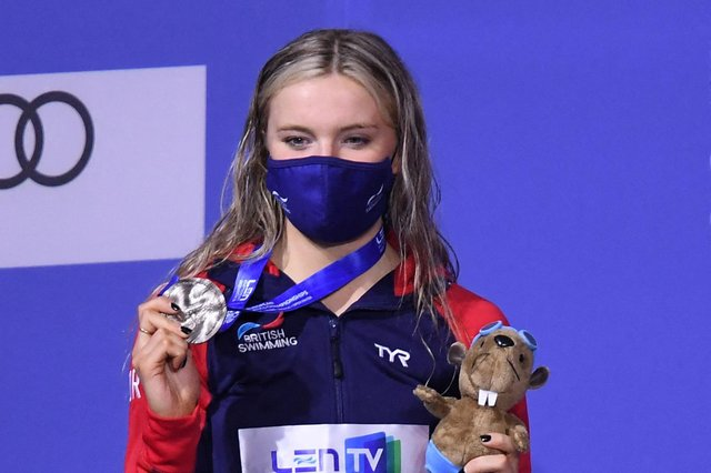 Abbie Wood poses on the podium after the final of the women's 200m individual medley at the LEN European Aquatics Championships at the Duna Arena in Budapest. (Photo by ATTILA KISBENEDEK/AFP via Getty Images)