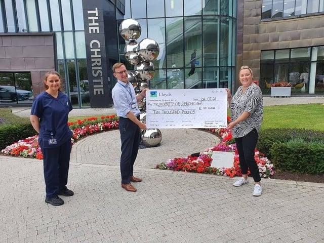 Gemma Ellis handing over the £10,000 cheque