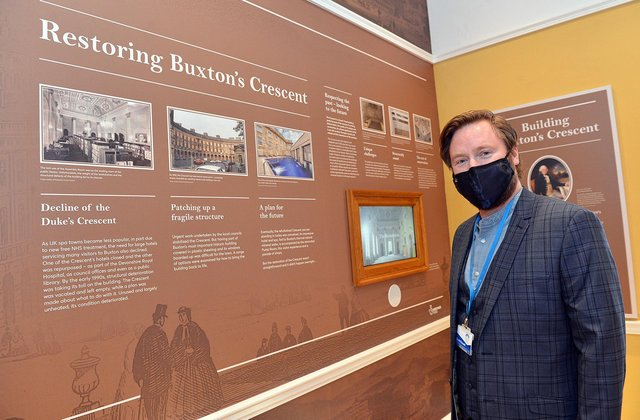 Scott Russell, the Trust's education development manager, at a timeline of the Crescent's history