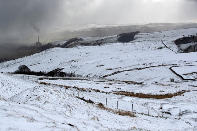 The distant Castleton cement works complete the wintry scene just hours before the clocks changed.