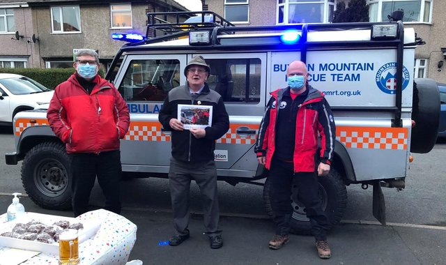 Members of Buxton Mountain Rescue Team making a special call-out to celebrate a former team member's 80th birthday
