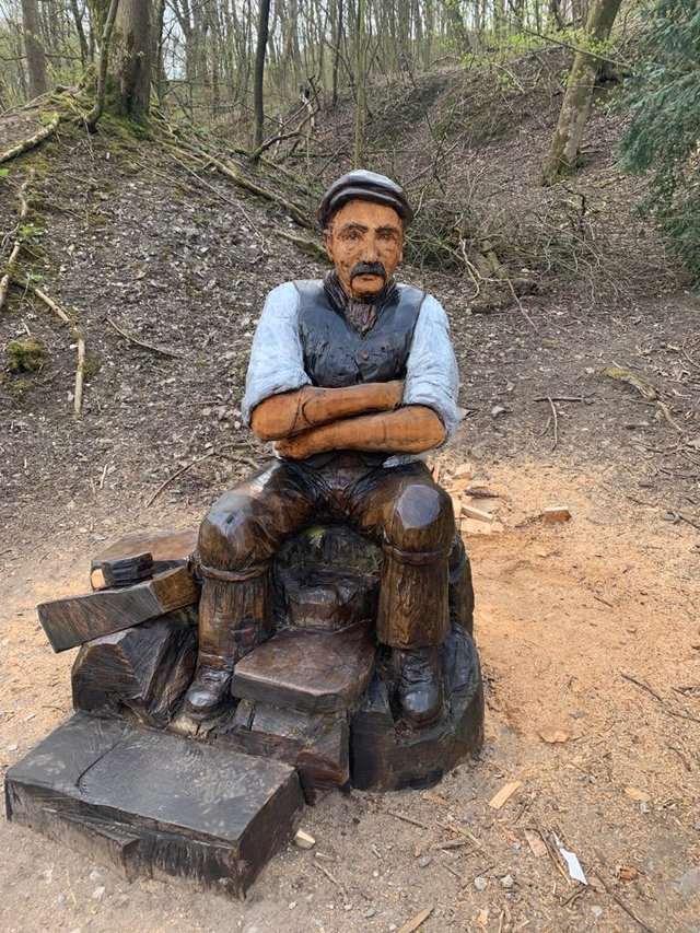 The newly restored Jack the Lime worker sitting proudly in Grin Low Woods once again