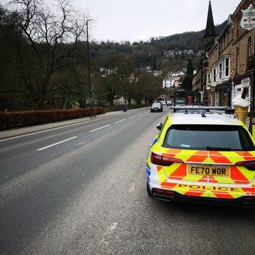 Police keep watch over the main road  through Matlock Bath
