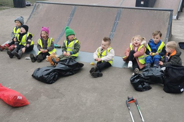 The High Peak Mini Litter Pickers who sat down for a well earned rest after tidiying their streets and the park