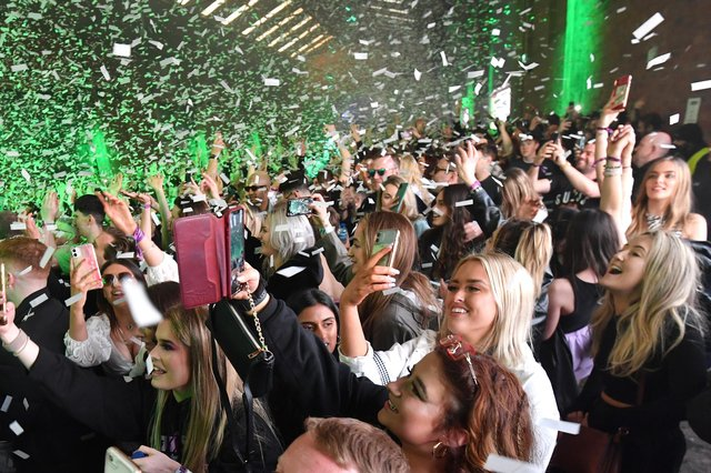 Confetti is fired into the crowd  (Photo by Anthony Devlin/Getty Images)