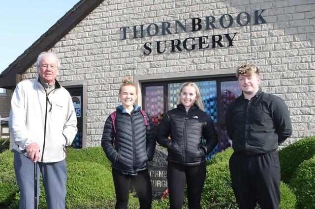 Stuart Boyt visits Thornbrook Surgery to thank volunteers Jess and Katie Christie and Sam Longden