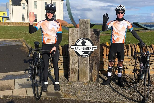 Lucas Parker and Isaac Brown at the start of their journey in John O'Groats.