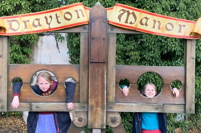 Jessica Ball, aged nine, and six-year-old Rebecca Ball in the stocks at Drayton Manor Theme Park.