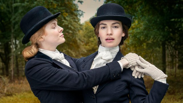Emily Beecham (Fanny) and Lily James (Linda) in BBC 1's The Pursuit of Love. Photo credit:  Theodora Fims & Moonage Pictures Limited/ Robert Viglasky.