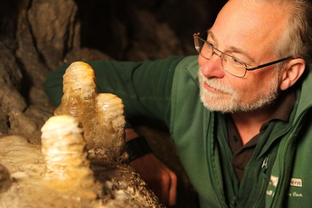 Pooles Cavern manager Alan Walker with some of the stalagmites that have been growing undisturbed during lockdown