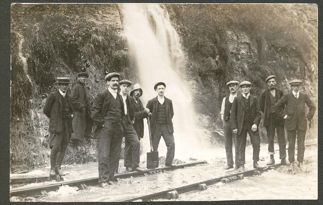 Floodwater gushing down onto the railway track at Bolsover didn't stop these men from having their photo taken before the First World War.