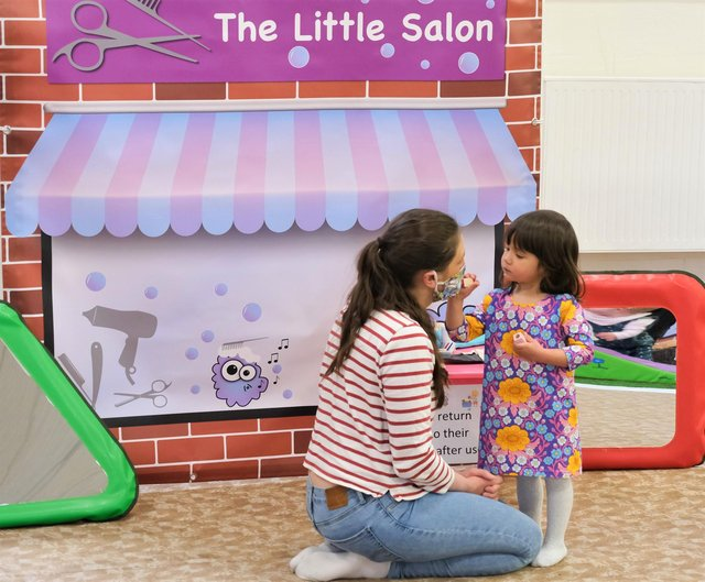A bonding moment in the new Little Salon