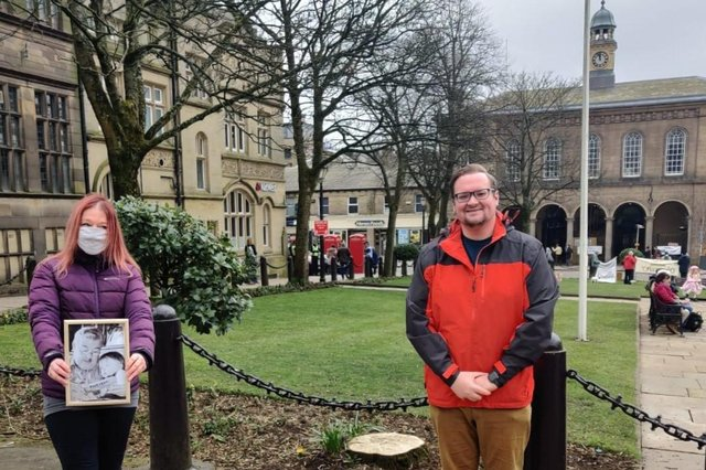 Shirley Woods-Gallagher, holding a picture of her as a young child with her father, and Councillor Damien Greenhalgh in Glossop's Norfolk Square where one of the memorial trees will be planted.