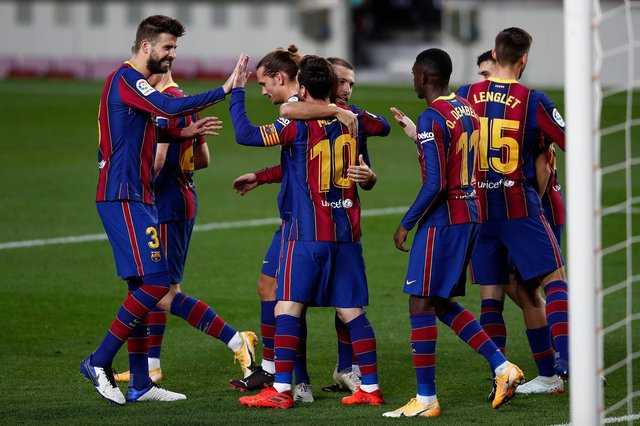 Lionel Messi celebrates with teammates after scoring for Barcelona against Real Betis. (Photo by Eric Alonso/Getty Images)