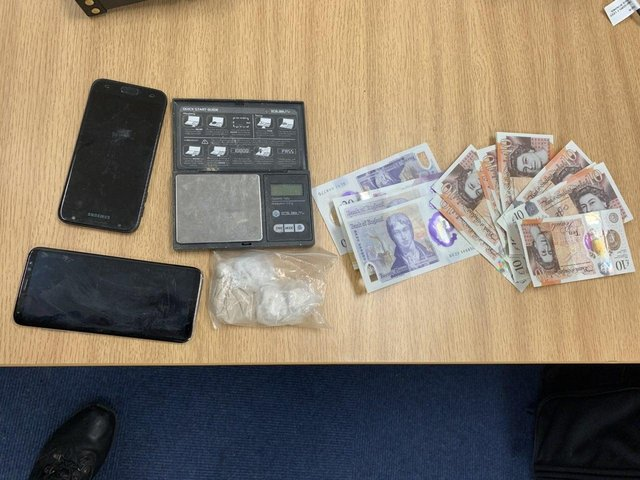 Cash, mobile phones and drugs are among the items seized. Photo - Buxton Safer Neighbourhood Team