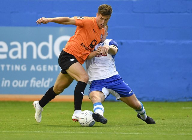 New Buxton defender Josh Granite in action for Barrow against Chesterfield.