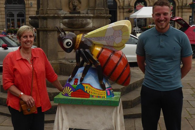 Billie the Buxton Bilberry bumblebee with artist Pam Smart and Potter's Manager Matt Nuttall standing in front of Turner's Memorial.