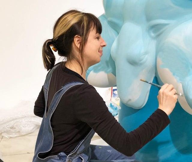 Lynne Hollingworth starts painting the ram.