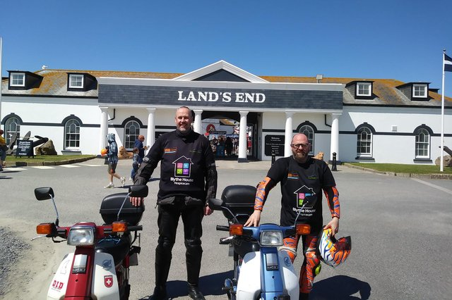Doug Gowans, left, and Dave Glossop conquered the country on their Honda C90 mopeds.