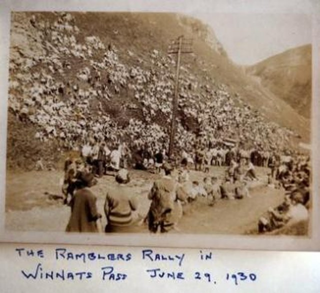 Archive photo of a Ramblers rally with members lining the slopes of Winnats Pass in 1930.