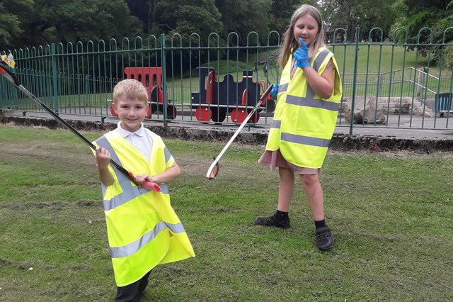 George and Eva Harwood cleaning up their local park last week.