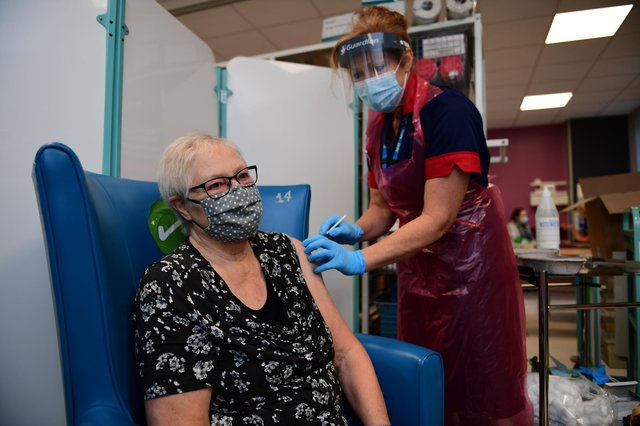 A nurse prepares to administer the Pfizer-BioNTech COVID-19 vaccine to patient Trixie Walker at the Northern General Hospital (Photo by Andy Stenning - Pool/Getty Images)