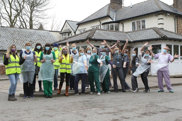 The vaccination team and some of the many volunteers celebrating reaching the 10,000 mark at Buxton's vaccination centre
