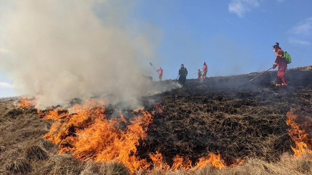 Firefighters tackling a large moorland fire at Rushup Edge on April 3.