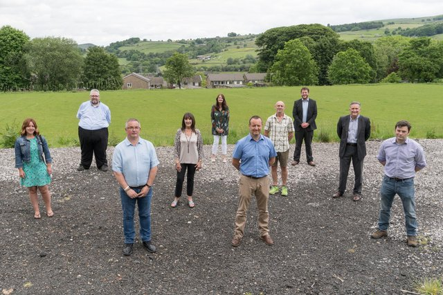 On the site of the planned pavilion, from left, Councillor Sally Curley, Councillor Anthony McKeown, COGS chairman Terry Watson, COGS members Sandy Schofield and Hilda Shepley, David Wilson from Tarmac Tunstead; COGS member Les Footitt; Councillor Alex Dale, Councillor Mike Glover, and Robert Largan MP.