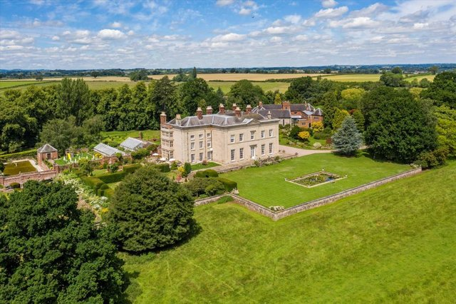 Surrounding the house are stunning formal tiered gardens with delightful rural views across its own land and beyond.