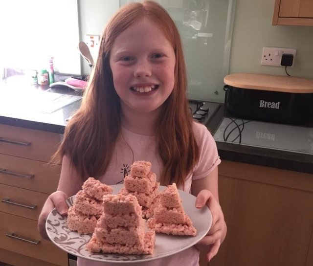 Maisie Bowers with her shortbread Egyptian pyramids