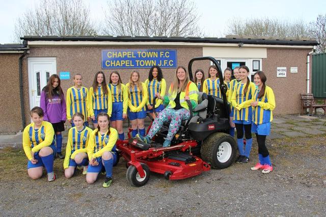The Chapel Town Football Club girls? team show off the new mower to Tarmac Tunstead Cement Plant?s environmental coordinator Josie Shereston